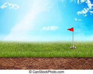 Golf hole in grass