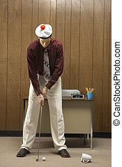 Golf in office.
