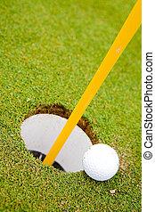 golf labda, kilyukaszt
