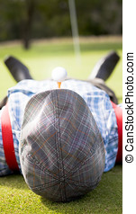 Golfer Relaxes Laying Down On A Golf Green Near The Ninth...