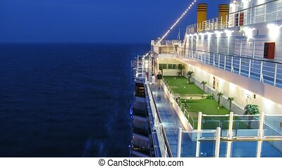 Golf pitch on cruise liner deck at evening time, time lapse
