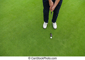 Golf player at the putting green