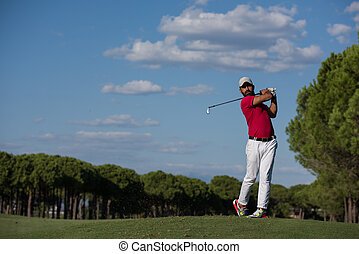 golf player hitting long shot - golf player hitting shot...