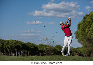 golf player hitting long shot - golf player hitting shot...