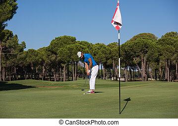 golf player hitting shot at sunny day - golf player hitting...