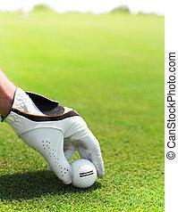 Golf player man holding golf ball