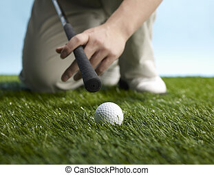 Golf Player Preparing to Hit Ball