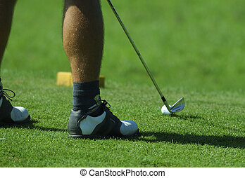 player shooting golf ball