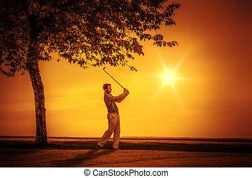 golf player sunset