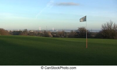 Golf Pole Flag Flapping in the Wind with Ball