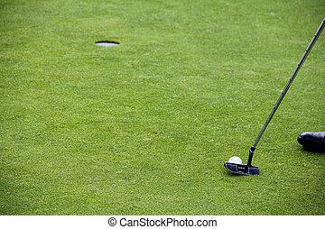 Golf putting on green