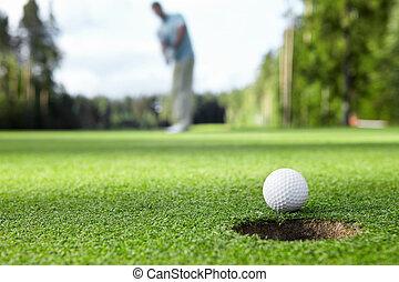 golf, spelend