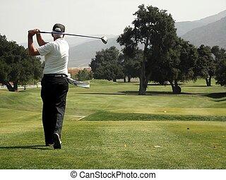 Golf - Teeing off down the fairway