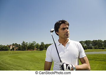 golf - Golf club: golfer concentrating on the next shot
