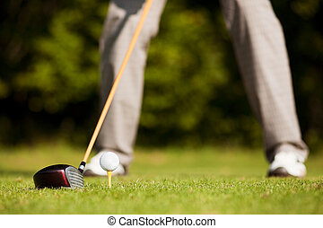 Golf teeing - Golf player attempting the tee stroke in the...