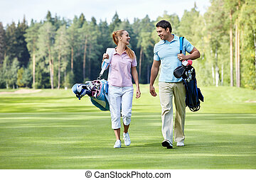 Golf - Young couple on the golf course