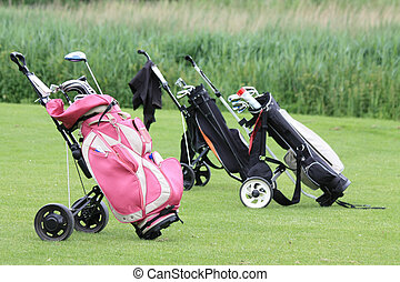 golfbags on the green