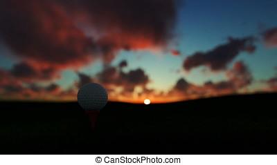 Golfball on tee against beautiful timelapse sunrise