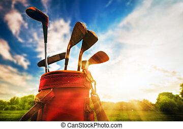 golfe, equipment., profissional, tacos golfe, em, pôr do sol
