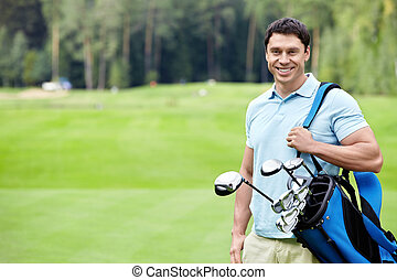 Golfer - A young man on the golf course
