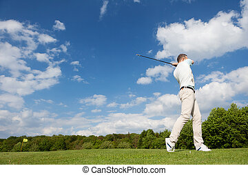 golfer against blue sky