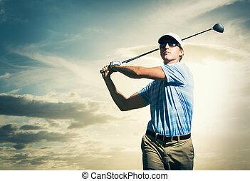 Golfer at sunset, Man swinging golf club with dramatic ...