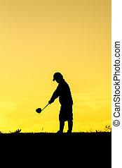 Golfer at sunset
