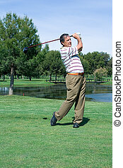 Golfer at the Tee - A Middle Aged Golfer at the Tee