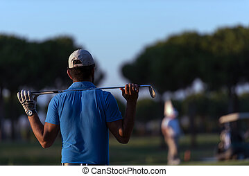 golfer from back at course looking to hole in distance