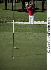 golfer hitting a sand bunker shot - golf player shot ball...