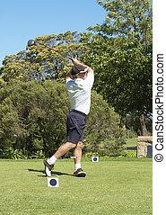 Golfer hitting the ball off the tee box