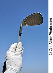 Golfer Holding an Iron (Golf Club)