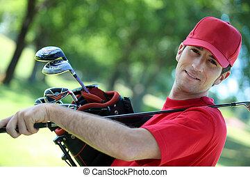 Golfer holding club over his shoulder.