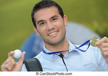 golfer holding golf ball
