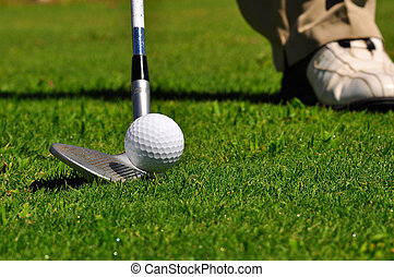 Golfer in a golf course - Real golfer ready to strike the...