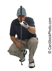 Golfer crouched down lining up a putt.