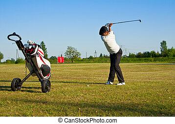golfer on the driving range