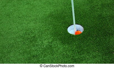 Golfer on the green misses a close putt