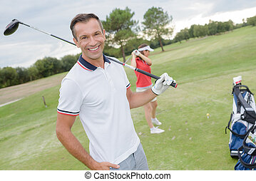 golfer posing for a picture