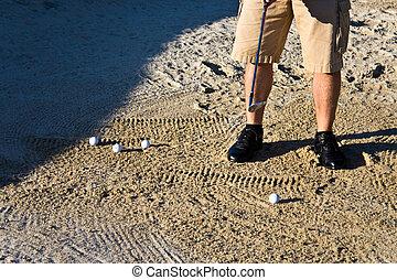 Golfer practicing from the sand bunker