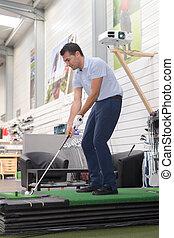 golfer practicing indoors