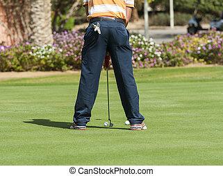 Golfer practising putting