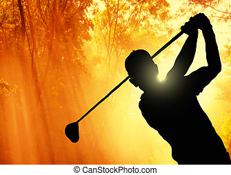 Golfer putting a ball on the green