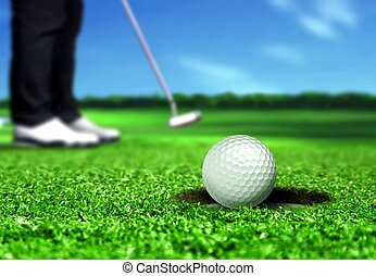 Golfer Putting the Ball into Hole