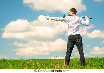 golfer showing his hand to the space on the left frame, man with a golf club