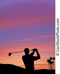 Golfer silhouette against colorful sunset sky - Golfer...