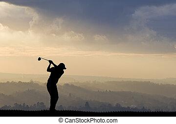 Golfer silhouette against stunning