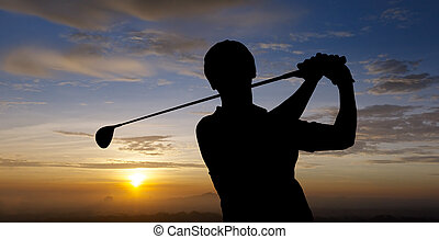 golfer silhouette during sunset with dramatic sky