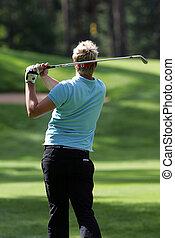 Golfer strikes a tee shot