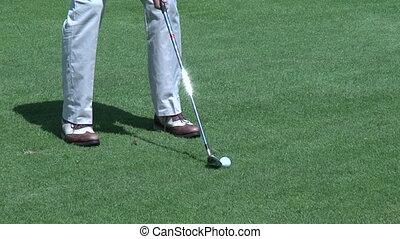 Golfer striking a ball